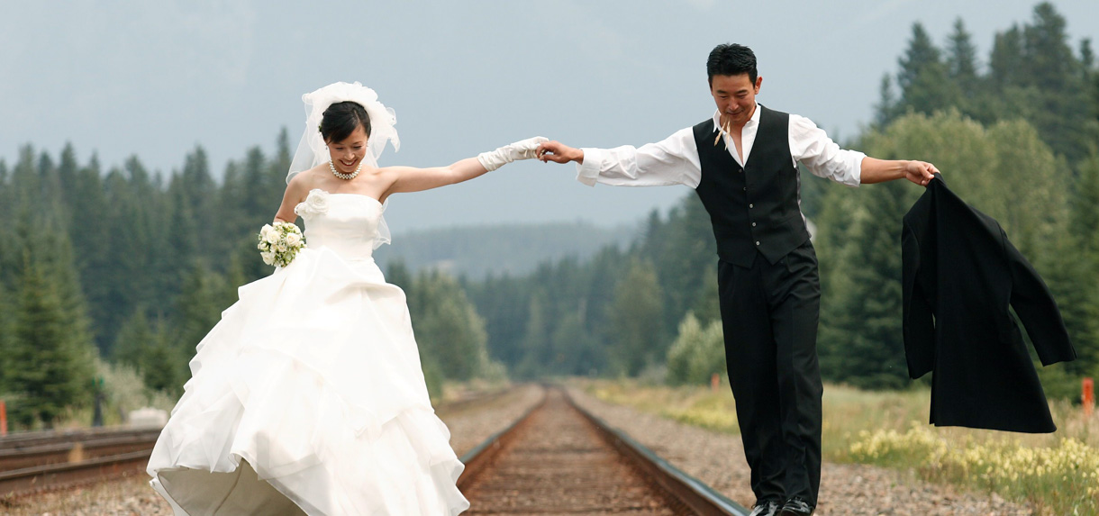 Happy couple on tracks